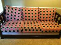 Solid wood frame sofa with very modern polka dotted