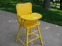 yellow wooden high chair, sliding tray call   Location: