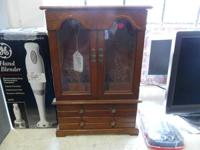 We are selling a wooden jewelry box, its the table top
