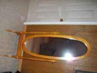 wooden mirror about 5 feet high great shape.  or
