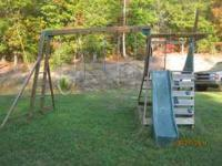 Wooden swingset with slide and monkey bars etc. Good