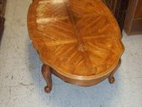 I have this wooden oval coffee table with beautiful