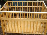 Old fashioned type crib, that folds up One side has a
