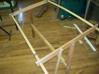 This is a manufactured wooden quilting frame. It can