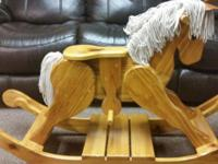 Wonderfully handcrafted wooden rocking equine with