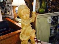 We have a Wood Santos- kind Cherub in our shop. Costing