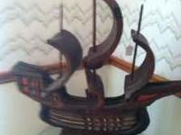 WOODEN SHIP $45 OBO YOU CAN ALSO HAVE GLASS TABLE FOR