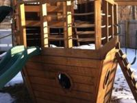 Like new wooden play yard , lots to do on it , paid