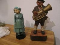 Wooden statues German man playing a tuba a woman