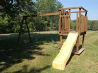 Custom made wooden swing set with slide and built in