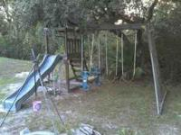 wooden swingset. most of the wood on the bottom and a