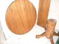 "Solid wood (Oak i believe) 48"" round table with"