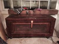 Large wooden trunk with copper piece on top. The piece