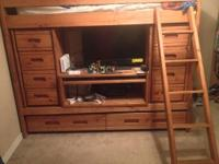 I am selling our wooden bunk beds. The bottom bunk is a