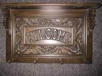 Beautiful dark wood Welcome sign/ coat holder. Would