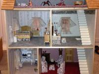 Beautiful 3-story wooden dollhouse. Scale 1 inch = 1