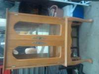 Wooden cabinet with mirror backing. 2 glass shelves.