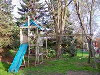 Large, older, wooden set with slide and fort area.