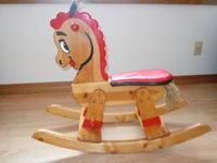 This is a handmade wooden rocking horse designed for