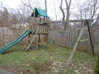 10 year old Playnation wooden swing set. Includes a fun