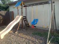 Very nice wooden swing set selling only for $120.