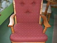 Hardwood frame, upholstered in good shape.  Lincoln