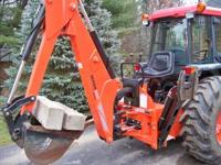 This is a like new backhoe attachment that is currently