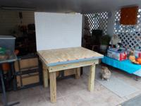 "Wooden work bench. 34 x 45"" top. Heavy duty and sturdy"