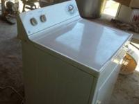 Offering an utilized washing device and a drier. Both