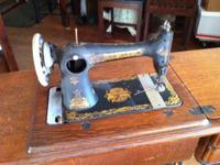 Antique Singer Sewing Machine. It works great & & is in