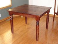 Selling a World Market Sourav Dining Room Table.  This
