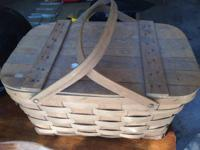 Woven picnic basket.  Comes from an non smoking home.