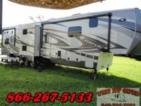 This luxurious and roomy 5th wheel toy hauler is 42ft