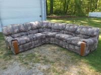 Wrap around couch w/ a recliner at each end. In good