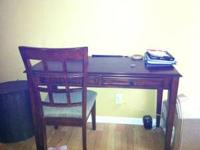 Writing desk with 2 drawers. Comes with chair. Please