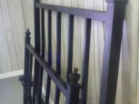 Black wrought iron bed with frame. The frame has been