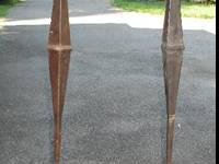 Two decorative, wrought iron candle holders. Candle
