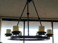 This is a black iron Chandelier that hangs 26 inches