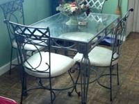 Good wrought iron table with glass top. Extremely
