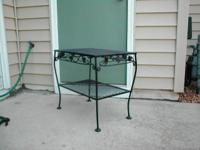 Wrought iron end table. 80 Yrs old. 24x16x21 inches.