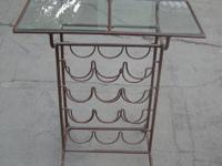 I have a very nice wrought iron wine rack with small