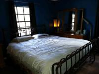 Really beautiful king size bed with wrought iron