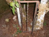 A LEFT OVER PIECE OF A VINTAGE WROUGHT IRON FENCE,