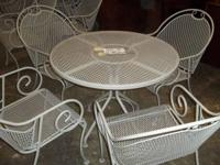 WROUGHT IRON PATIO AREA TABLE & 4 CHAIRS very sturdy
