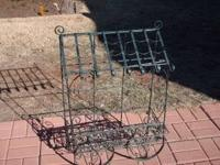 Very cute, iron cart looking plant holder. Does not