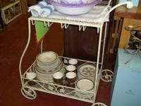 This charming wrought iron tea cart would be great in a