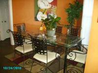 wrought iron glass top dining room table. 6 chairs.