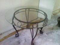 I have a wrought iron kitchen table with glass top for