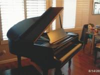 This is a 1926 Wurlitzer Baby Grand Piano for sale. The