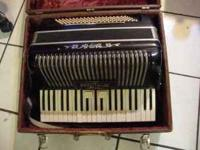 Wurlitzer Accordion + Case. Older. $125. Please email